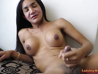 Ladyboy Som makes her tiny dick stronger and jerks it.