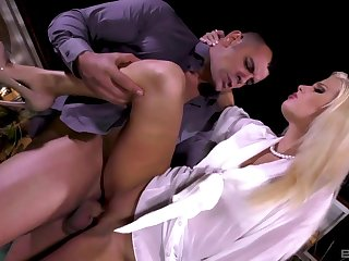 Sexy blonde enjoys a midnight fuck standing