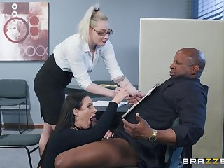 Angela White spreads the brush legs for a friend's black gumshoe vulnerable the table