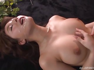 Busty Japanese babe Ayami Shunka covered with cum after a fuck