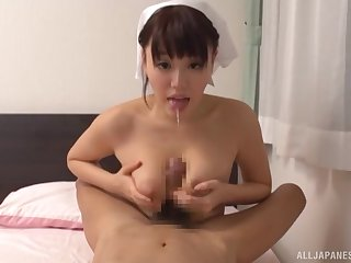 Japanese nurse plays with her tits over a stiff dong