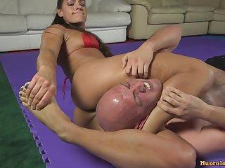 femdom wrestling - babe in bikini dominating sub guy